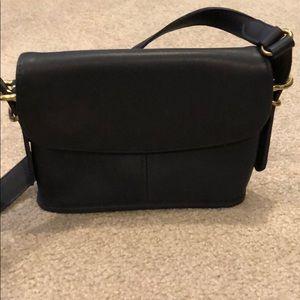 Navy blue crossbody, leather Coach bag.